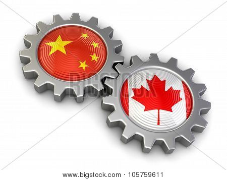Canadian and Chinese flags on a gears (clipping path included)