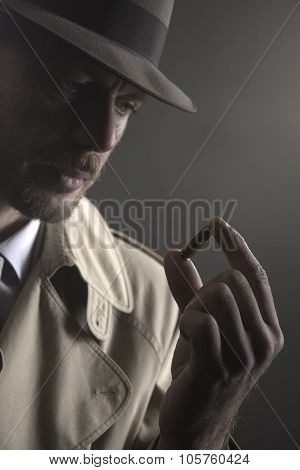 Detective Holding A Bullet