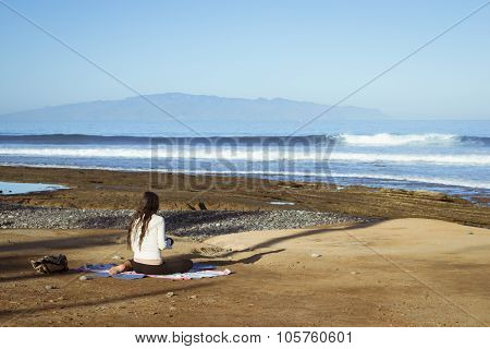 Young Girl Meditates Sitting
