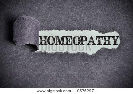 Homeopathy Word Under Torn Black Sugar Paper