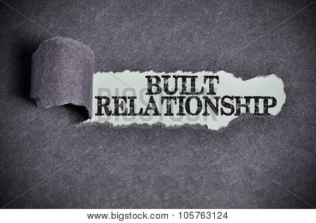 Built Relationship Word Under Torn Black Sugar Paper