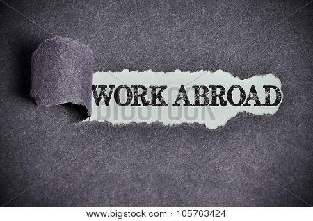Work Abroad Word Under Torn Black Sugar Paper