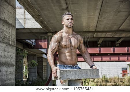 Sexy construction worker shirtless with muscular body