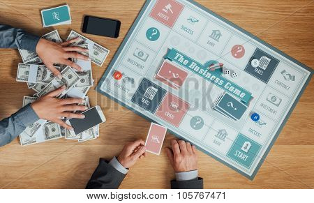 People Playing The Business Board Game