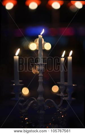 White Candlestick With Burning Candles