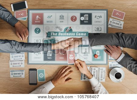 Business People Playing A Board Game