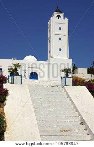 Tunisia, Africa - August 02, 2012: Mosque In Sidi Bou Said  In Summer Day
