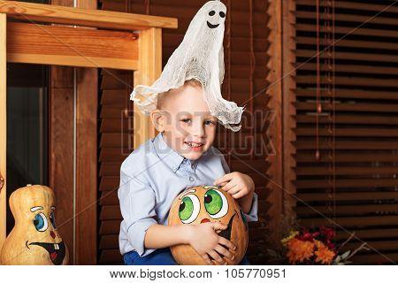 Cute Little Boy Having Fun In Halloween Decorations