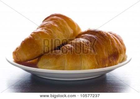 2 Croissants On A Plate