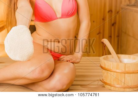 Woman In Sauna With Exfoliating Glove. Skincare.