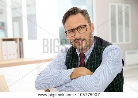Portrait of confident handsome man with eyeglasses