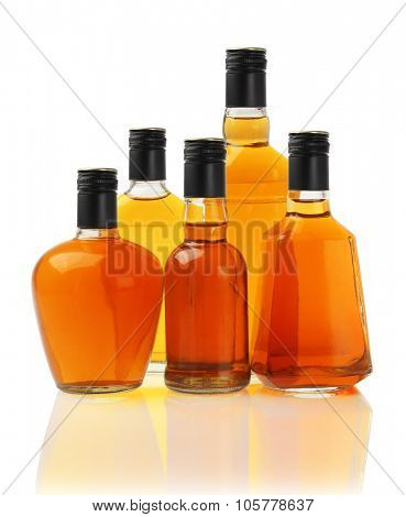Collection of Alcoholic Drinks in Glass Bottles on White
