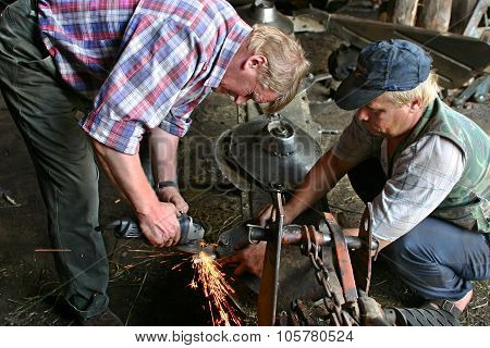 Two Workers Farm, Farming Equipment Repair In Mechanical Workshop.