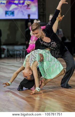 Minsk, Belarus -september 27, 2015: Unidenrified Dance Couple Performs Juvenile-2 Latin-american Pro