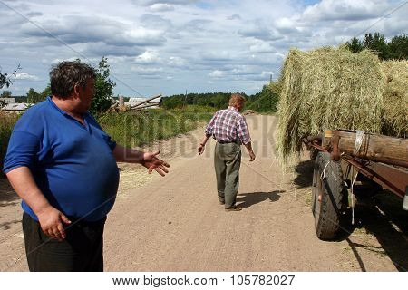Russian Peasants, Farmers Discussed Steps During Transport Hay Bale.
