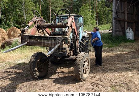 Peasant Deals With Tractor-driver Forklift  Intended For Pickup Hay Bale.