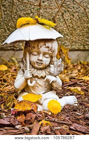 Young Girl Holding Umbrella And Bird Statue