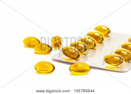 fish oil supplement product capsules in foil panel isolated on white background