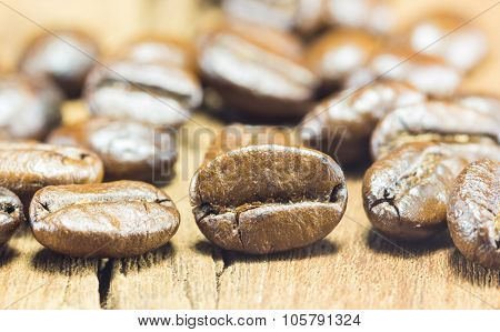 Coffee Beans  Texture  On The Wood Background,selective Focus,worm Toning