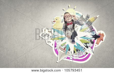Wideangle picture of funny schoolgirl with paper plane