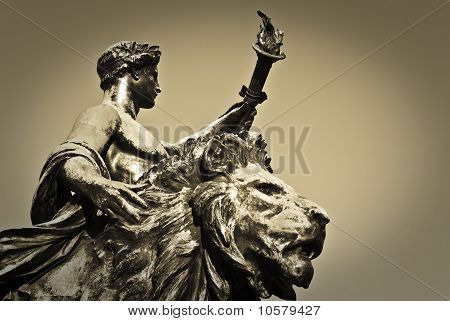 Torch Bearer And Lion Statue