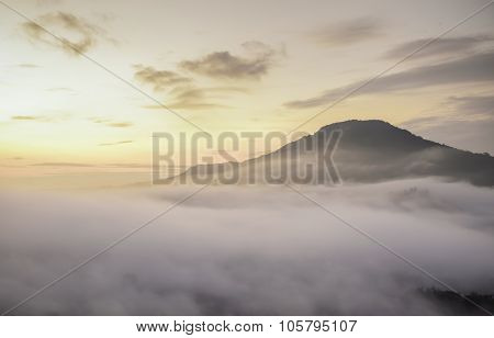 Bright Saturated Color Dawn Above The Sea Of Fog Over The Mountain