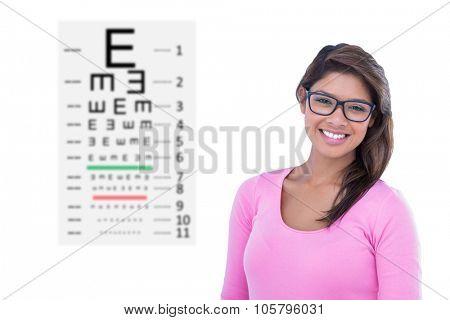 Portrait of beautiful woman wearing geek glasses against eye test