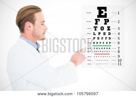 Optician in coat pointing eye test against eye test