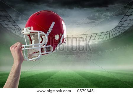 A helmet of an american football player against rugby stadium