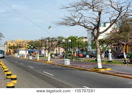 LIMA, PERU - OCTOBER,18 2015: Street scene in the Barranco District of Lima, Peru. A park divide the street in the trendy and up and coming area of restaurants hotels and artisians.