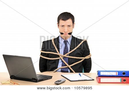 Businessman Tied Up With Rope And Gagged With Band