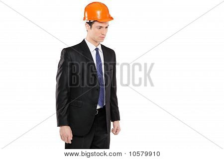 A Foreman In A Suit Looking