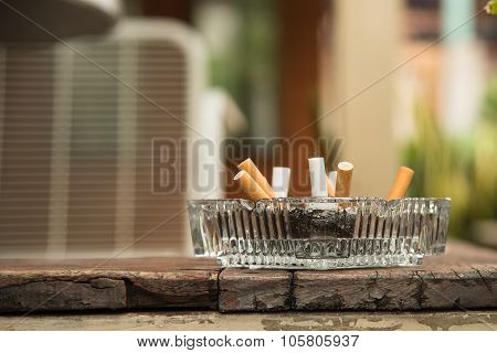 Ashtray On Wood Plank