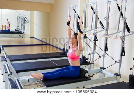 Pilates reformer woman rowing row exercise workout at gym indoor
