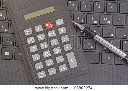 calculator and laptop keyboard