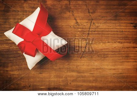 Christmas Present Wrapped And Tied With Red Ribbon