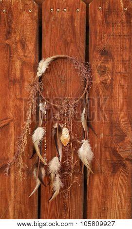 native american bad dream catcher on wood