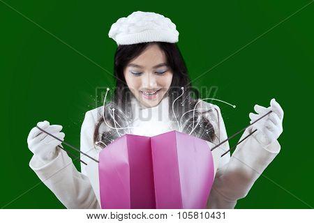 Happy Hispanic Girl Opening Shopping Bag