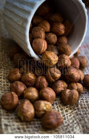 Hazelnuts On The Rustic Background