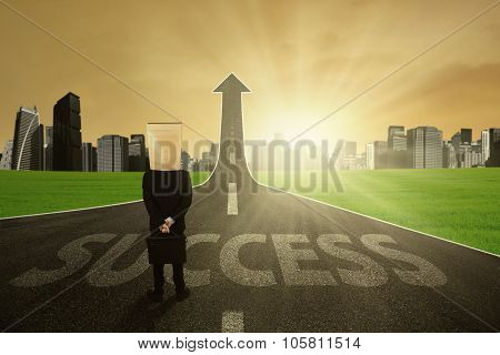 Man With Pasteboard Head On The Success Road