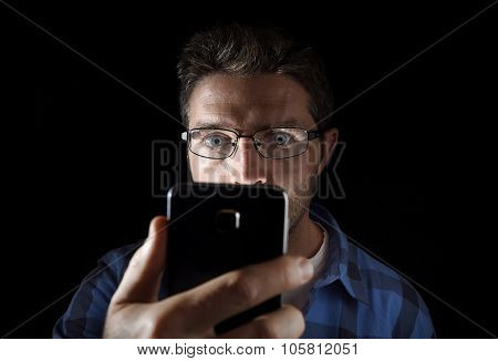 Close Up Portrait Of Young Man Looking Intensively To Mobile Phone Screen With Blue Eyes Wide Open I