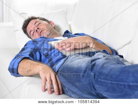Young Attractive Man Sleeping At Home Couch Relaxing After Working With Digital Tablet Pad