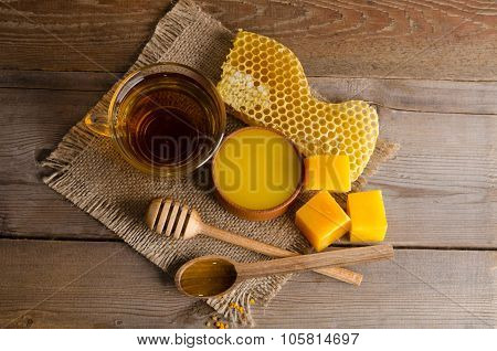 Still Life From Cup Of Tea, Honey, Wax And  Honeycombs On Wooden Table