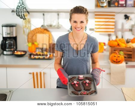 Happy Housewife Holding Tray With Baked Halloween Biscuits