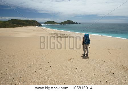 Hiker On Beach Sand Dune