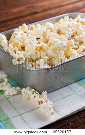 Aluminum Plate Full Of Salty Popcorn On Towel