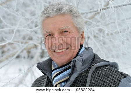 Senior man standing  in winter