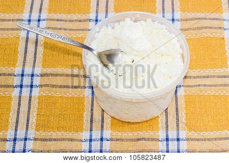 Container Of Cottage Cheese With Tea Spoon