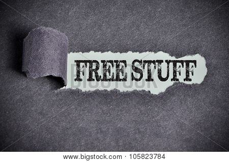 Free Stuff Word Under Torn Black Sugar Paper