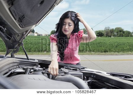 Frustrated Woman Repairing Broken Car